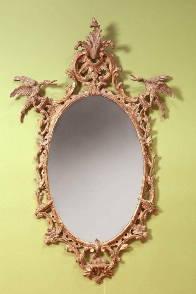 An oval rococo mirror